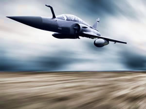 Military jet plane traveling at high speed, symbolizing a fast, tune-up computer